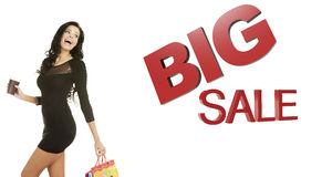 Sale concept. Woman with shoping bags. Isolated on white stock photography