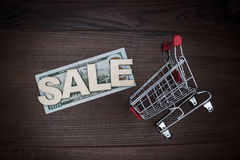 Sale concept on the wooden background Royalty Free Stock Images