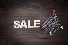 Sale concept on the wooden background Stock Photography