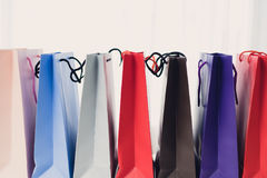 Sale, consumerism, advertisement and retail concept. Many colorful shopping bags royalty free stock photo