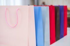 Sale, consumerism, advertisement and retail concept. Many colorful shopping bags Stock Photos