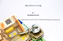 Sale contract for house or apartment with euro bank notes and keys Royalty Free Stock Photography