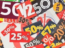 Sale coupons are cutted from magazins. Paper sale coupon with rabatt in half price are cutted from newspaper Royalty Free Stock Photos