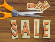 Sale in cut letters Royalty Free Stock Photography
