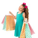 Sale. Cute little girl with many shopping bags. Portrait of a kid on shopping. royalty free stock images