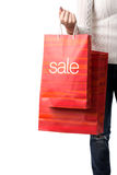 SALE, detail photo of a woman holding the hands of sale bags Royalty Free Stock Images