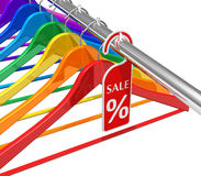 Sale and discount concept. Row of colorful rainbow hangers with promotion label isolated on white background Stock Images