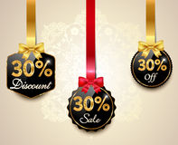 Sale,discount golden labels with red bows, ribbons 30 off Tags. Created sale,discount golden labels with red bows, ribbons 30 off Tags Stock Images