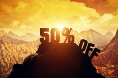 50% off writing on a mountain peak. 3d. Sale discount illustration. 50% off writing on a mountain peak. Special offer Royalty Free Stock Photos