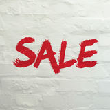 Sale and Discounts Background. Red Sale banner on white brick wall Stock Images