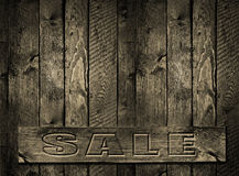 SALE engraved inscription   wood background Stock Images