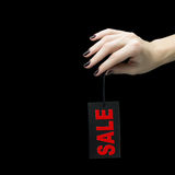 Sale etikett på kvinnahanden Fotografering för Bildbyråer