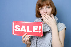 Sale expectation. A young woman holds an empty poster Royalty Free Stock Photo