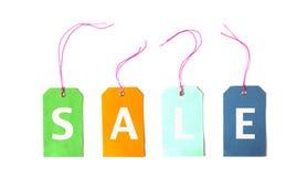 Sale färgrik etikett som binds för hängningisolat på vit bakgrund Royaltyfria Foton