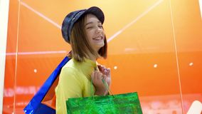 Sale and fashion concept. Kid with confident face expression and casual hairdo does shopping. stock video
