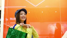 Sale and fashion concept. Kid with confident face expression and casual hairdo does shopping. stock video footage
