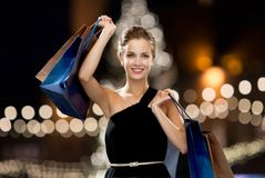 Woman in black with shopping bags at christmas Stock Photography