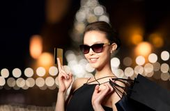 Woman with credit card and shopping bags Royalty Free Stock Images
