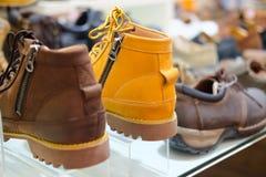 Sale fashionable man`s a boot in shoe shop. Sale fashionable man`s a boot in men shoe shop Stock Photos