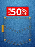 Sale fifty percentage off. Sale off tag in blue denim pocket Stock Photos