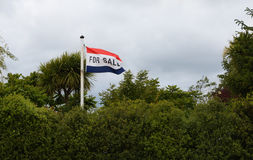 For Sale Flag. Flowing in the wind Stock Photo