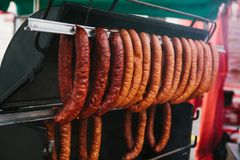 Sale of food on the traditional street market in the European city. Sale of delicious sausages in the market. European. Sale of sausages in the market. European Stock Photography