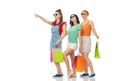 Happy female friends with shopping bags Stock Photos