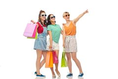 Happy female friends with shopping bags stock photography