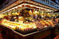Sale of fruit drinks and other food in the Boqueria market in Barcelona.  royalty free stock photography