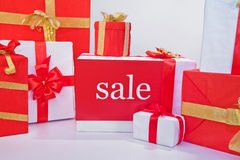 Sale of gift boxes. On a white background closeup Royalty Free Stock Images