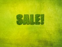 Sale on grass background. Label sale on grass background Stock Images