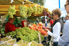 Sale of green grapes and peaches Stock Photos