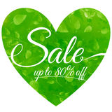 Sale on green heart with leaves. Seasonal sales Royalty Free Stock Images