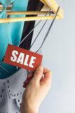 Sale with hand. Sale, elegant clothes with tags bid, with hand stock photos