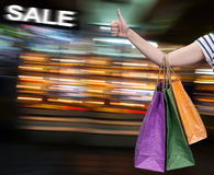 Sale. Hand with shopping bags Stock Photos