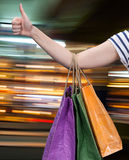 Sale. Hand with shopping bags Royalty Free Stock Photography