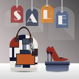 SALE hanging tags with fashionable women purse and high heels Stock Images