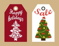 Sale Happy Holidays Decorative Tags New Year Trees. Sale happy holidays decorative tags with New Year Christmas trees hanging badges, shopping promotional labels Stock Photos