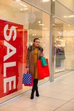 Sale: happy woman shopping in shopping mall. Sale: Young and happy woman shopping in shopping mall Stock Photo