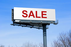Sale on highway billboard sign. Highway billboard sign with the word sale on it Royalty Free Stock Image