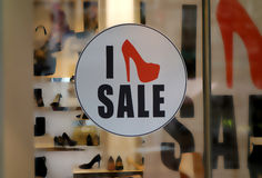 Sale. Icon on display window of shoe shop Stock Photos