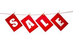 SALE inscription on the clothesline royalty free stock photos