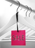 Sale label. Colorful sale label concept and clotheshangers Royalty Free Stock Photography