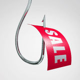 Sale label on hook Royalty Free Stock Photography