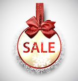 Sale label with red gift bow. Stock Photography