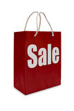 Sale label on red shopping  paper bag Royalty Free Stock Photo