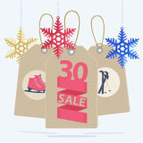 Sale labels for a Christmas sport sale. Sale labels for a Christmas sale of sports gear and equipment showing a 30 percent reduction on ice skates and skis Royalty Free Stock Photography