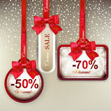 Sale labels with red gift bows. Set of sale and discount paper labels with red bows and ribbons Royalty Free Stock Photo