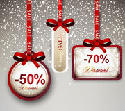 Sale labels with red gift bows. Stock Photos