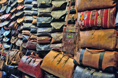 Sale of leather shopping bags, background of a bag. Leather handbags of different colors and shapes are on sale in the market Stock Images
